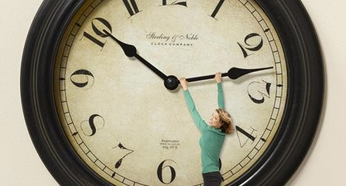 Woman hanging on clock hand